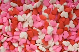 s day candy hearts up of tiny candy hearts in pink and white
