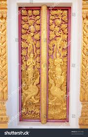 thai wood carving red door paint stock photo 92321458 shutterstock