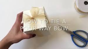 tying gift bows how to tie a bow basic gift wrapping