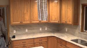 Kitchen Countertops And Backsplash Pictures Cashmere Creme White Granite Countertop Outlets In The Backsplash