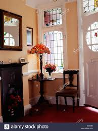 stained glass windows and door in traditional hall with fireplace