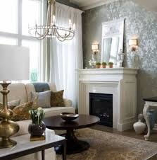 living room with fireplace and wall sconces also damask wallpaper