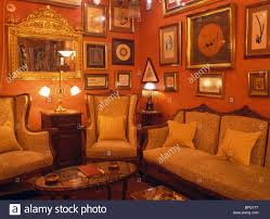 Living Room Lighting Traditional Pictures Covering Walls Of Red Turkish Living Room With