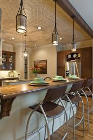 hickory wood ginger prestige door lighting over kitchen island
