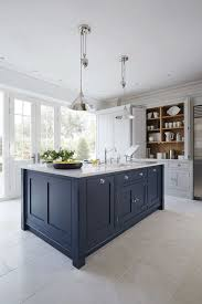 should your kitchen island match your cabinets i saw a great exle of a muted navy kitchen island with white