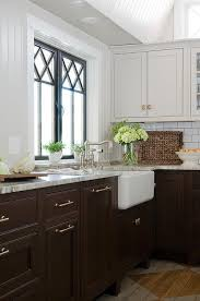brown and white kitchen cabinets dark brown cabinets with gold pulls transitional kitchen