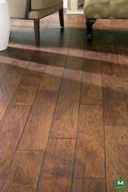 kinleigh laminate flooring provides a sleek yet simple aesthetic