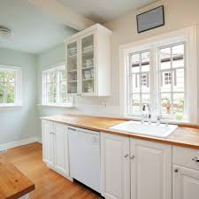 what color to paint a small kitchen with white cabinets painting strategies that make a small kitchen look larger