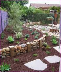 pebble and rock river bed for garden drainage mac pinterest