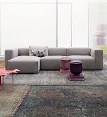 living room with area rugs and grey modular sofa trendy and