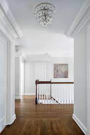 wholesale home decor online photos hgtv transitional white hallway with elegant lighting