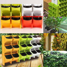 self watering vertical 3 pocket garden wall planter outdoor