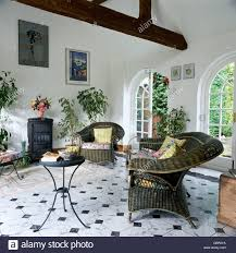 Grey Tile Living Room by Grey Wicker Armchairs And Small Metal Table In White Living Room