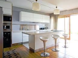 kitchen black bench white cupboards white kitchen with black bench