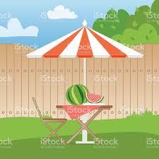 summer picnic on the backyard table with chairsumbrella watermelon