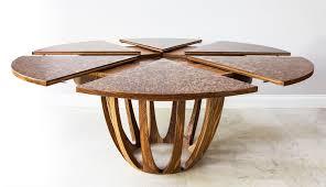 expanding circular dining table brown oak expanding circular dining table johnson furniture