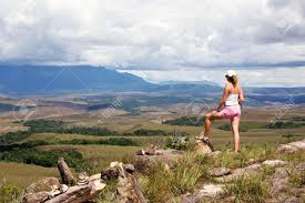 Table Top Mountain by Women Tourist Looking At Table Top Mountains Called Tepui In
