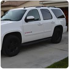 white lexus black rims white tahoe with pink emblems black rims and taillights
