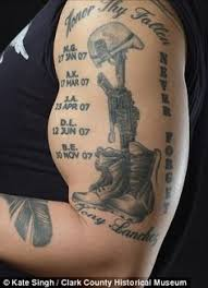 military skull soldier tattoo on biceps photos pictures and