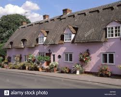 pleshey thatched roof cottages with dormer windows and rendered