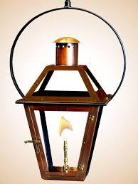 electric lights that look like gas lanterns flambeaux bourbon street style hanging yoke bracket gas lantern