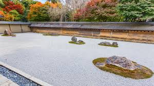 a zen rock garden in ryoanji temple in kyoto royalty free stock
