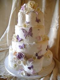 pretty cake with and butterflies like different