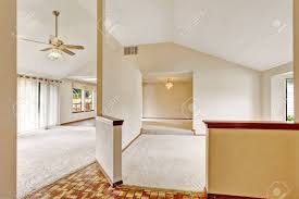 vaulted ceiling floor plans open floor plan in empty house with vaulted ceiling and carpet