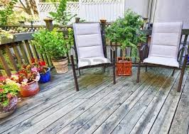 Backyard Wood Deck Wooden Deck On House With Chairs And French Doors Stock Photo