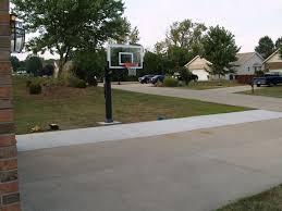 front view of the front yard basketball court