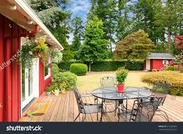 Beautiful Decks And Patios by Beautiful Bright Red House Patio Area Stock Photo 212359669