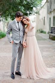 blush wedding dress with sleeves picture of a blush wedding dress with a plunging neckline