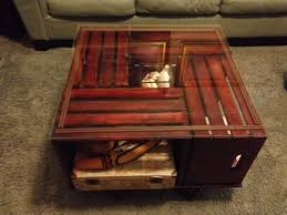crate coffee table with a glass top i would put glass over it