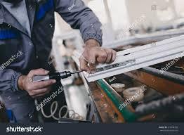 glass doors jobs manual worker assembling pvc doors windows stock photo 519148180