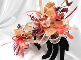 wrist corsages for homecoming coral orchid and burgundy with ivory pearl wrist corsage