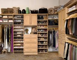 closet decor ideas featuring open shoe racks and hanging clothing