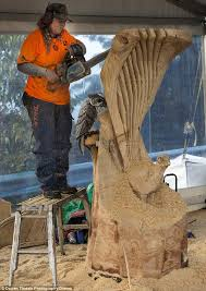 the world s loudest form chainsaw sculptors turn chunks