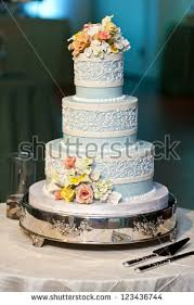 three tiered blue white wedding cake stock photo 123436744