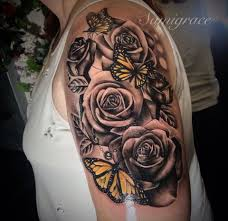 roses and butterfly s piercings and tats