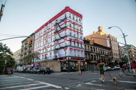 the story behind the most colorful apartment building in nyc