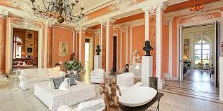 luxurious salmon paint color for a grand living room with white