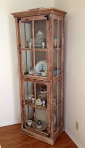 cost plus world market curio cabinet used as china hutch in dining