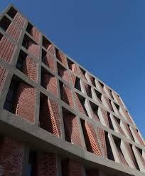 caat studio uses bricks to diversify low cost apartment complex in
