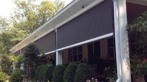 motorized retractable exterior solar shades transform a patio
