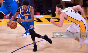 justin of the new york knicks breaks away from larry nance