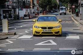 bmw m4 convertible spotted in speed yellow color