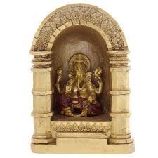 decorative gold and ganesh ornament