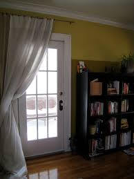beautiful glass doors to curtain off patio door to save cooling costs w thermal