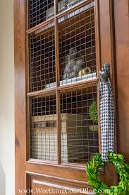 how to put chicken wire on cabinet doors how i gave my entertainment center a makeover without paint