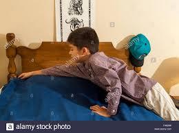boy making bed stock photos u0026 boy making bed stock images alamy